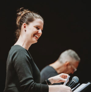 Vocalist Karly Epp, smiling and enjoying a fun moment during a rehearsal with pianist, Earl MacDonald.